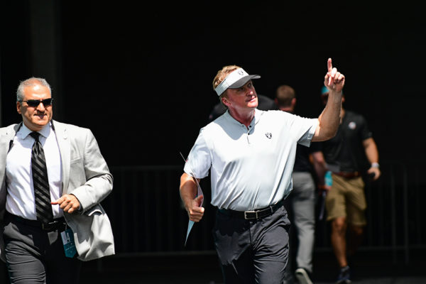 Oakland Raiders head coach Jon Gruden points to the fans as he runs out to the field