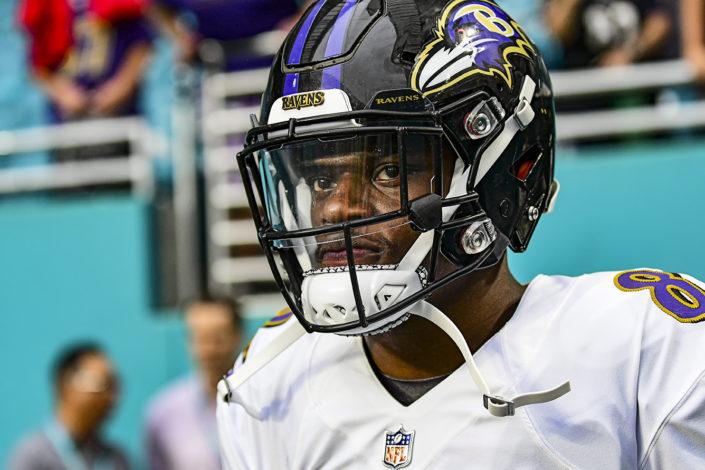 quarterback Lamar Jackson (8) of the Baltimore Ravens walks out to the pregame warmup