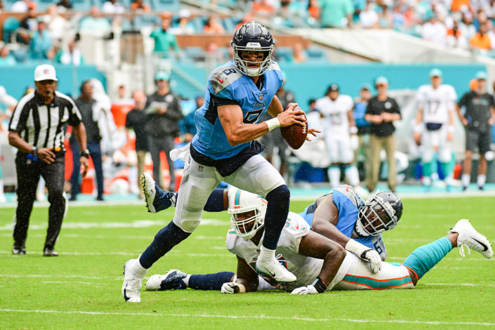 Tennessee Titans quarterback Marcus Mariota (8) runs out of the pocket