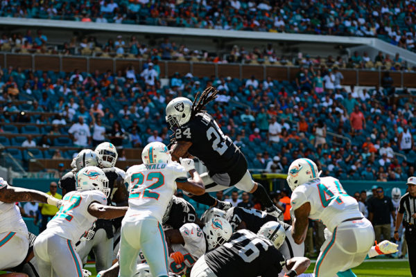 Oakland Raiders running back Marshawn Lynch (24) leaps over the pile