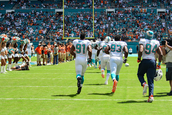 Miami Dolphins defensive end Cameron Wake (91) runs onto the field with his teammates