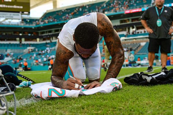 Miami Dolphins cornerback Xavien Howard (25) writes a message on his jersey