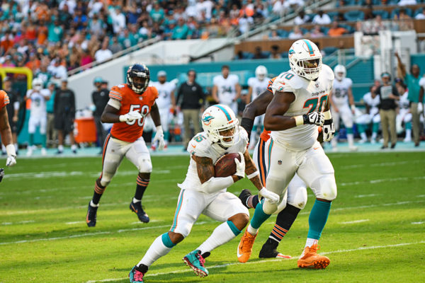Miami Dolphins wide receiver Albert Wilson (15) cuts through the defense on his way to a touchdown