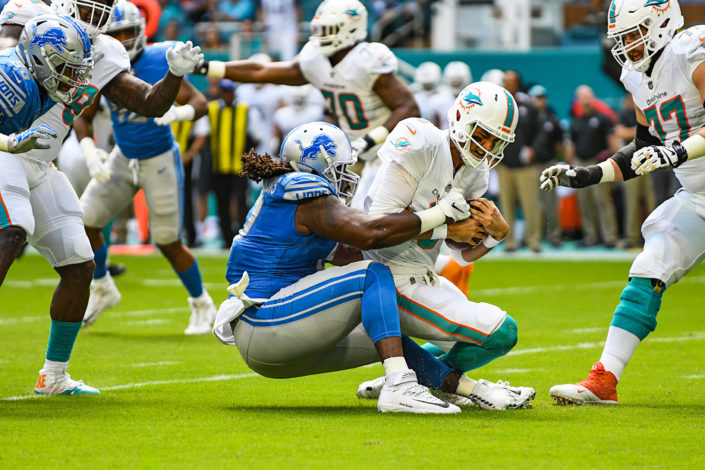 Detroit Lions defensive tackle Ricky Jean Francois (97) sacks Miami Dolphins quarterback Brock Osweiler (8)