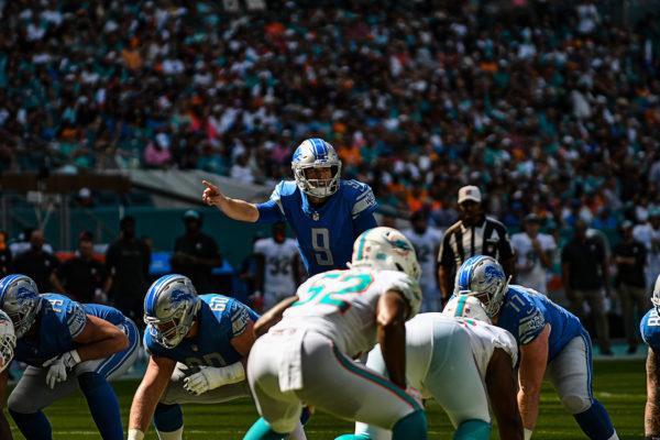Detroit Lions quarterback Matthew Stafford (9) calls out a defense