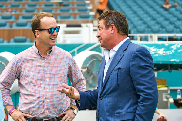 Peyton Manning and Dan Marino share a laugh pregame