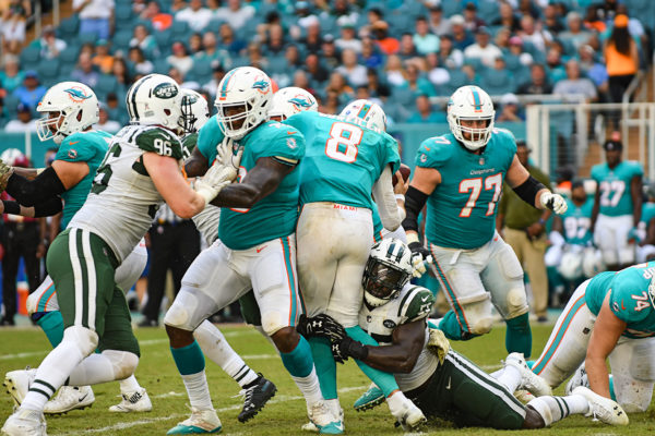 New York Jets linebacker Jeremiah Attaochu (55) sacks Miami Dolphins quarterback Brock Osweiler (8)