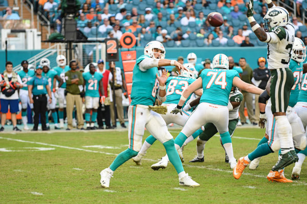 New York Jets strong safety Jamal Adams (33) tries to bat down the past Miami Dolphins quarterback Brock Osweiler (8)