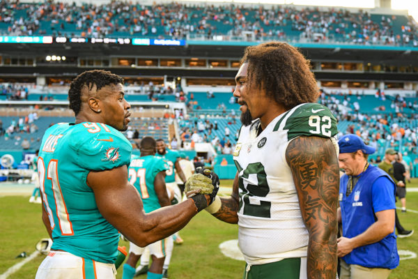 Miami Dolphins defensive end Cameron Wake (91) and New York Jets defensive end Leonard Williams (92)