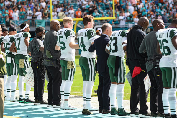 New York Jets quarterback Sam Darnold (14) and the Jets stand for the national anthem