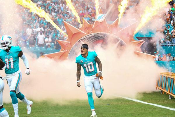 Miami Dolphins wide receiver Kenny Stills (10) runs through the smoke