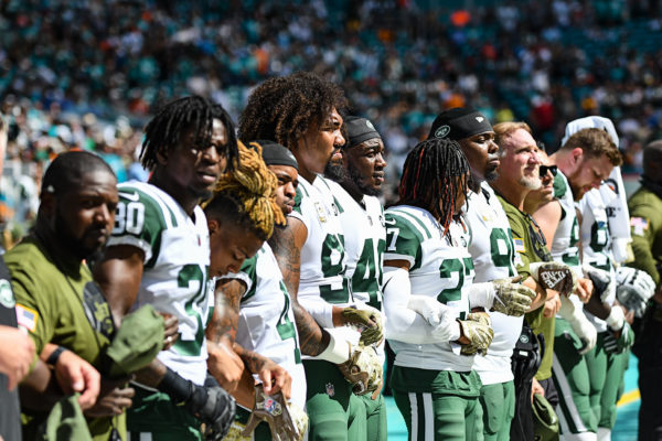New York Jets line up for the national anthem