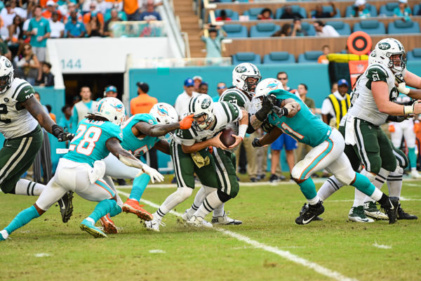 Miami Dolphins defensive end Andre Branch (50) grabs the facemask of New York Jets quarterback Sam Darnold (14)
