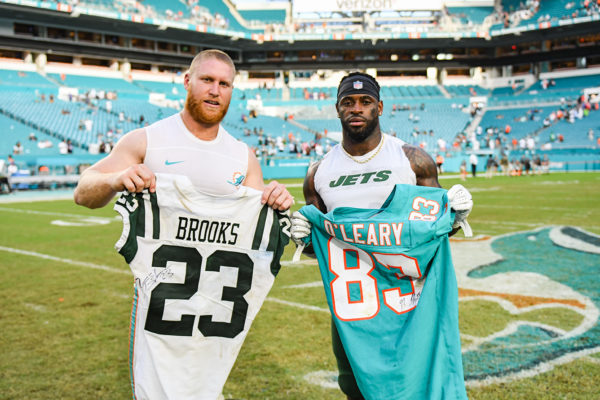 Miami Dolphins tight end Nick O'Leary (83) and New York Jets defensive back Terrence Brooks (23)