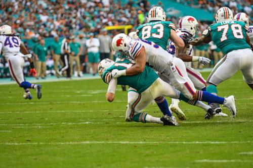 Buffalo Bills outside linebacker Lorenzo Alexander (57) sacks Miami Dolphins quarterback Ryan Tannehill (17)