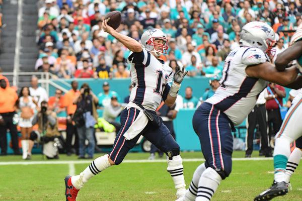New England Patriots quarterback Tom Brady (12) throws a pass