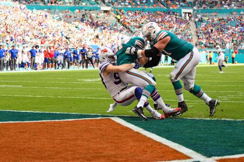 Buffalo Bills defensive end Trent Murphy (93) sacks Miami Dolphins quarterback Ryan Tannehill (17)