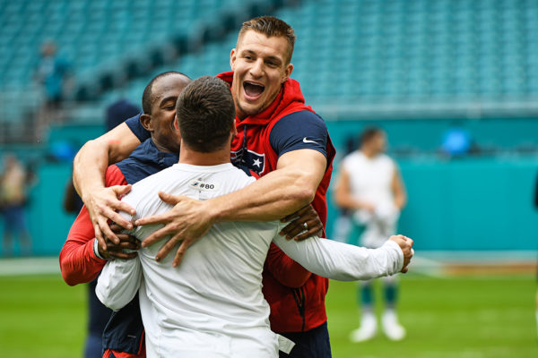 New England Patriots tight end Rob Gronkowski (87) hugs Miami Dolphins wide receiver Danny Amendola (80)