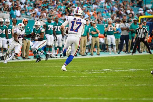 Buffalo Bills quarterback Josh Allen (17) runs for a first down