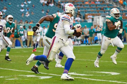 Buffalo Bills quarterback Josh Allen (17) scrambles