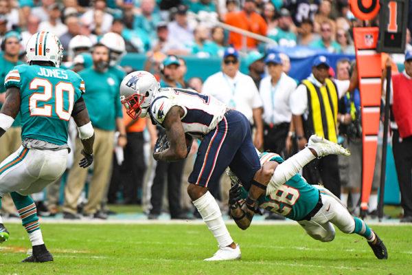 Miami Dolphins cornerback Bobby McCain (28) tackles New England Patriots wide receiver Josh Gordon (10)