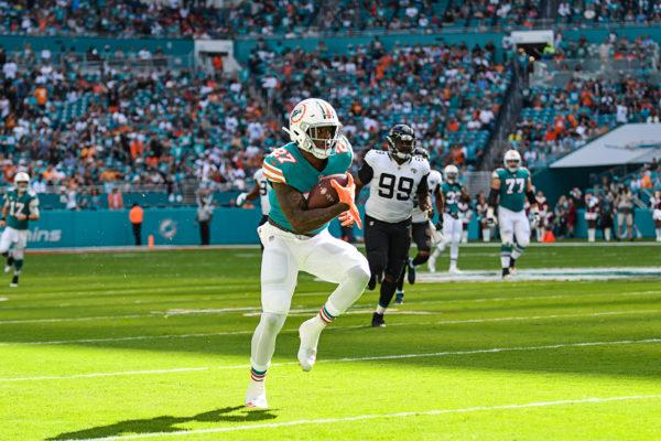 Miami Dolphins running back Kalen Ballage (27) runs up the sideline