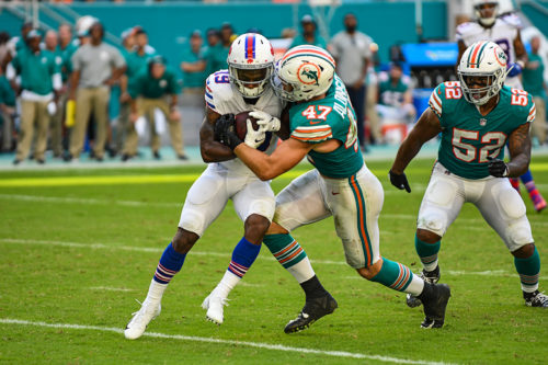 Miami Dolphins outside linebacker Kiko Alonso (47) with the hit on Buffalo Bills wide receiver Isaiah McKenzie (19)
