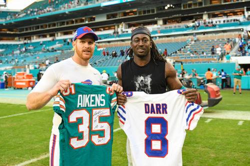 Miami Dolphins defensive back Walt Aikens (35) and Buffalo Bills punter Matt Darr (8)