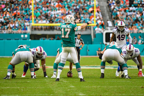 Miami Dolphins quarterback Ryan Tannehill (17) points out the defense