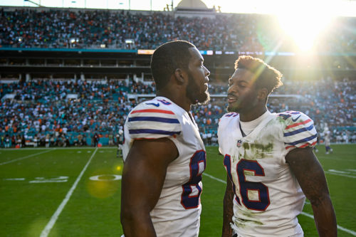 Buffalo Bills wide receiver Robert Foster (16) tries to encourage Buffalo Bills tight end Charles Clay (85)