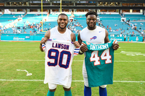 Buffalo Bills defensive end Shaq Lawson (90) and Miami Dolphins linebacker Stephone Anthony (44)