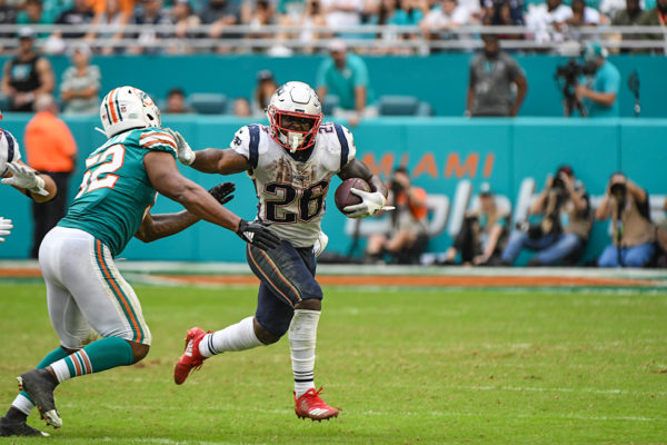 New England Patriots running back Sony Michel (26) with a stiff arm
