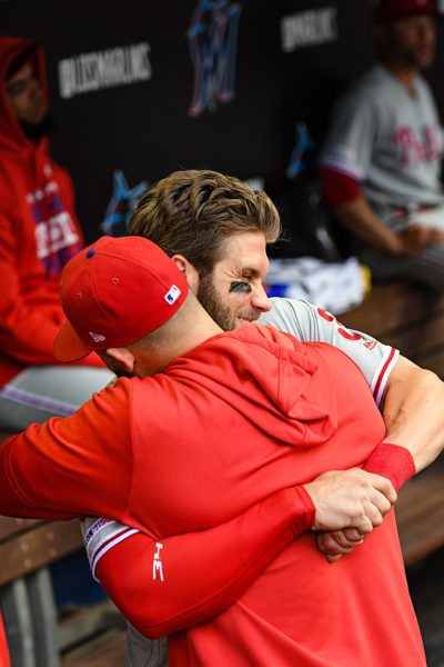 Philadelphia Phillies right fielder Bryce Harper (3) hugs it out in a pregame ritual
