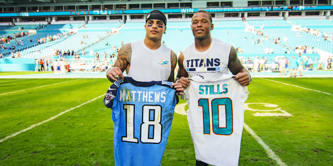 Kenny Stills and Rishard Matthews exchange jerseys after the game